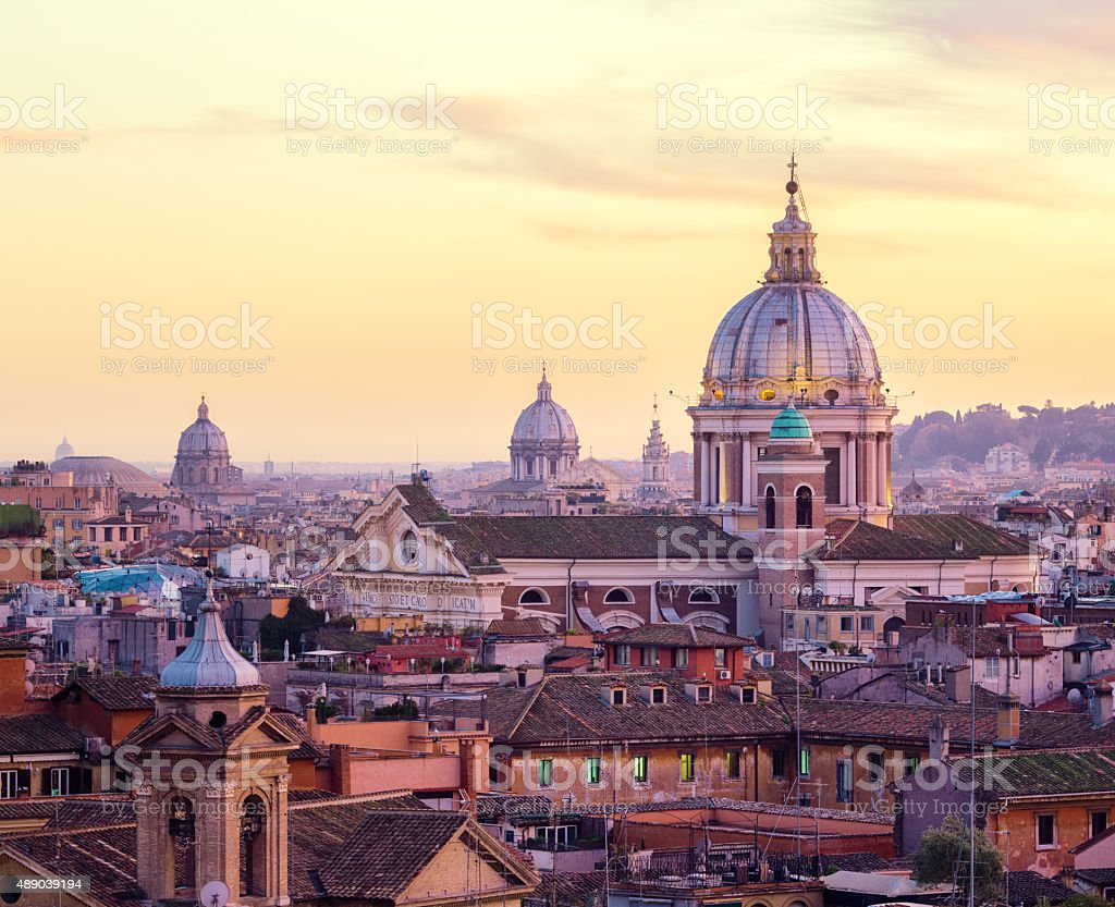 Rome skyline with church cupolas at dusk, Italy stock photo