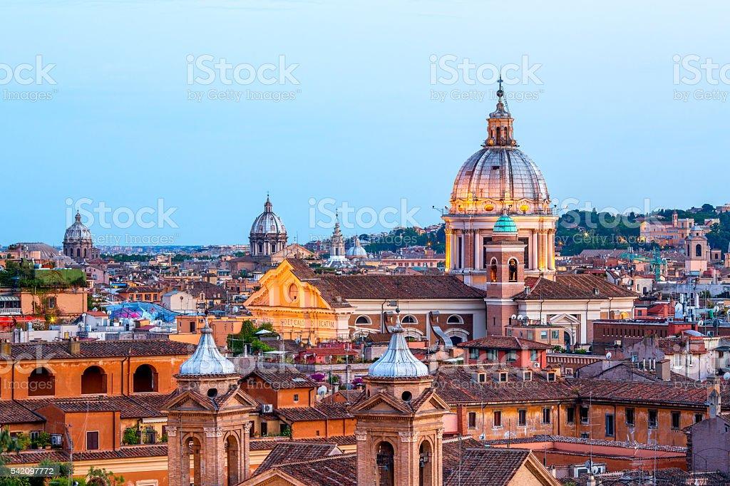 Rome skyline with church cupolas at dusk, Italy stock photo