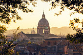 Rome skyline with church cupolas at sunset, Italy