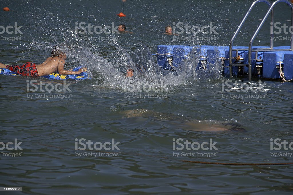romping kids in water royalty-free stock photo