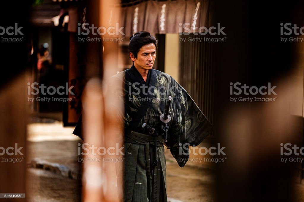 Ronin Samurai Warrior With Katana in a Traditional Japanese Village stock photo