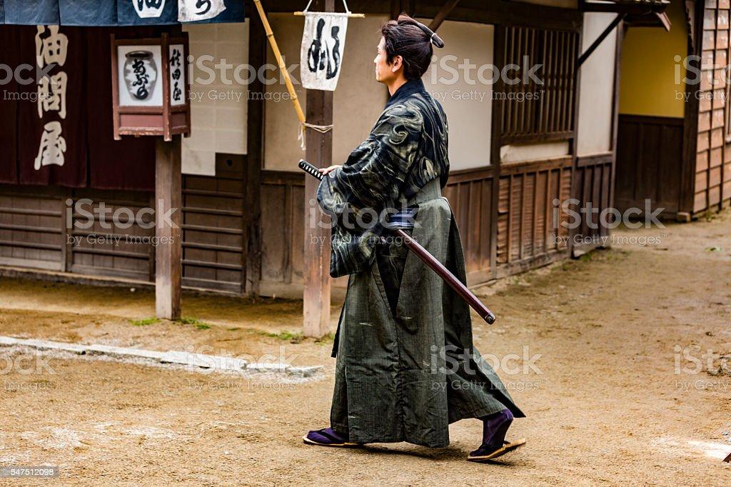 Ronin Samurai Warrior With Katana in a Traditional Japanese Village stock photo