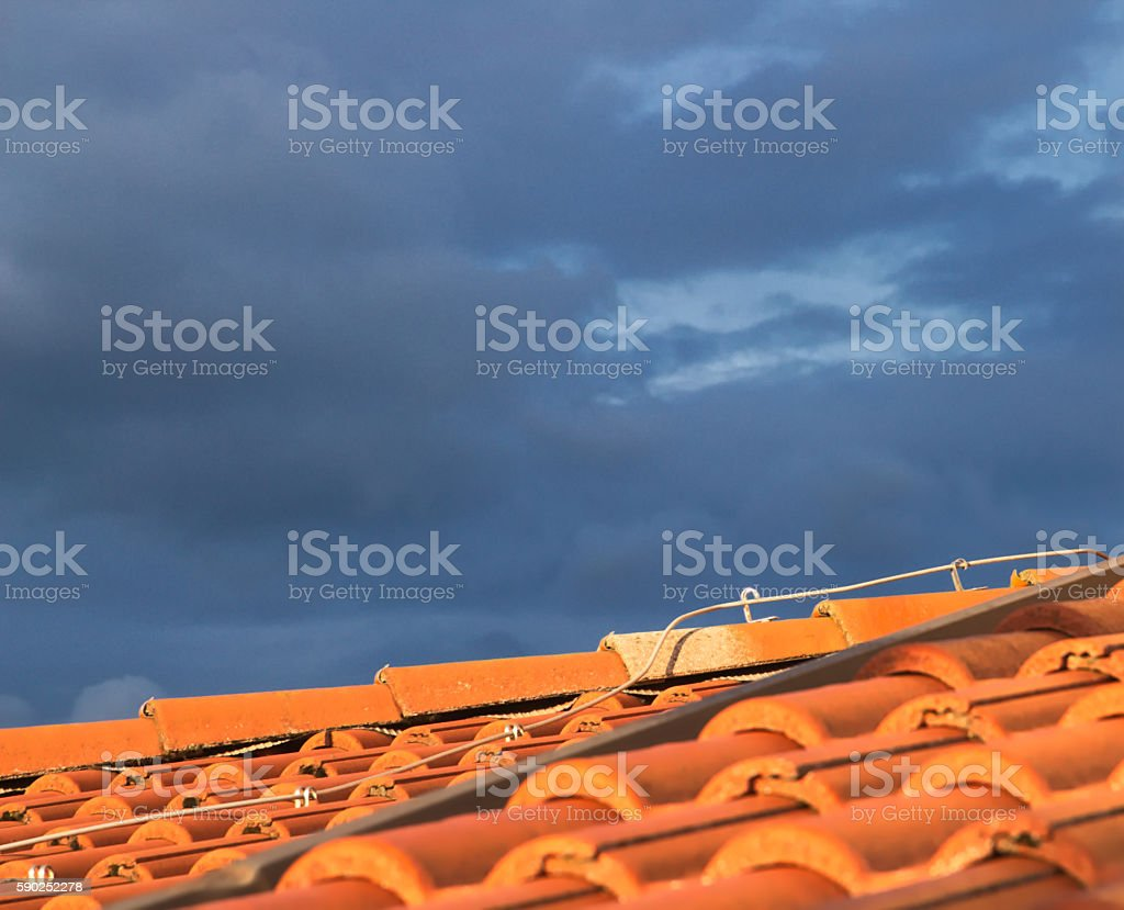 Roof and dark stormy sky stock photo