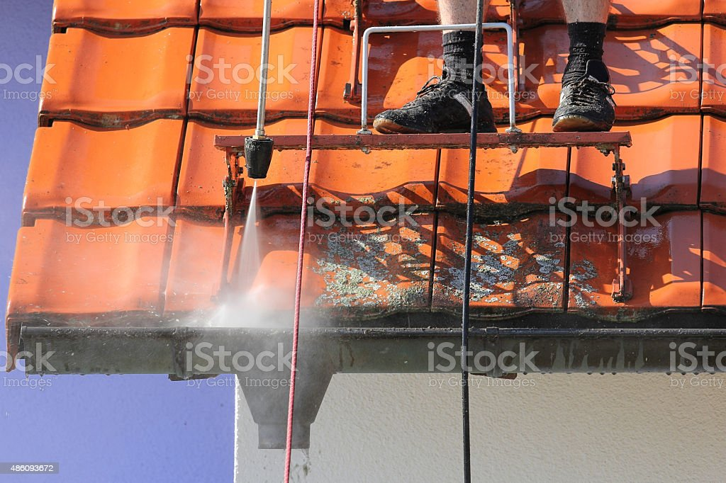 Roof and gutter cleaning with high pressure stock photo