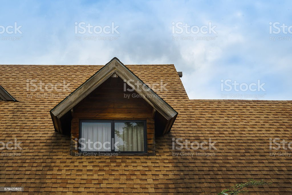 Roof and window of wooden cabin stock photo