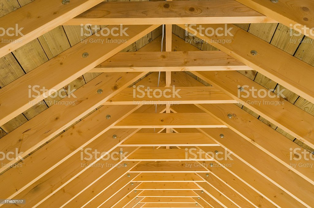 Roof beams in attic space stock photo