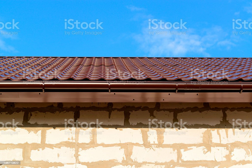 roof brown metal with plastic gutter system stock photo