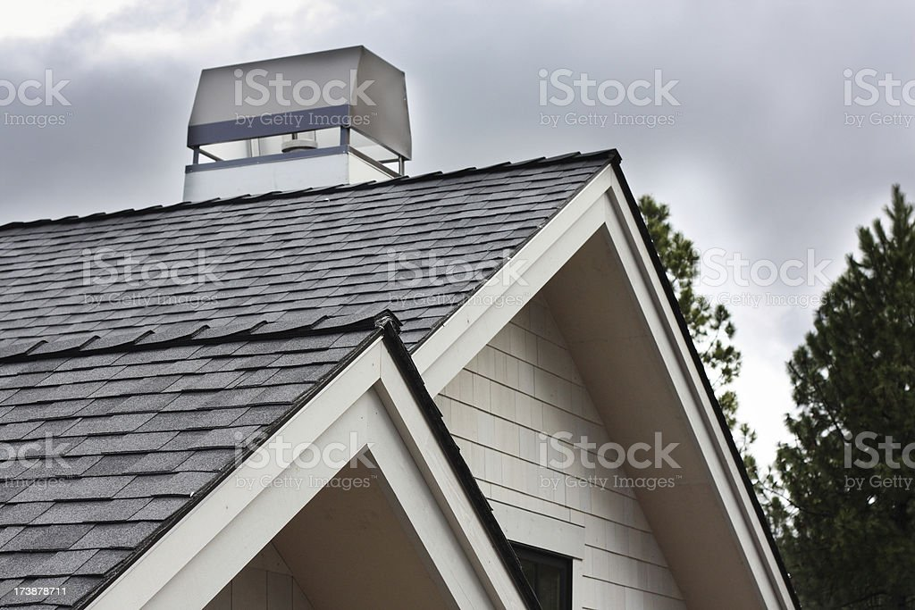 Roof eaves with fascia trim and chimney royalty-free stock photo