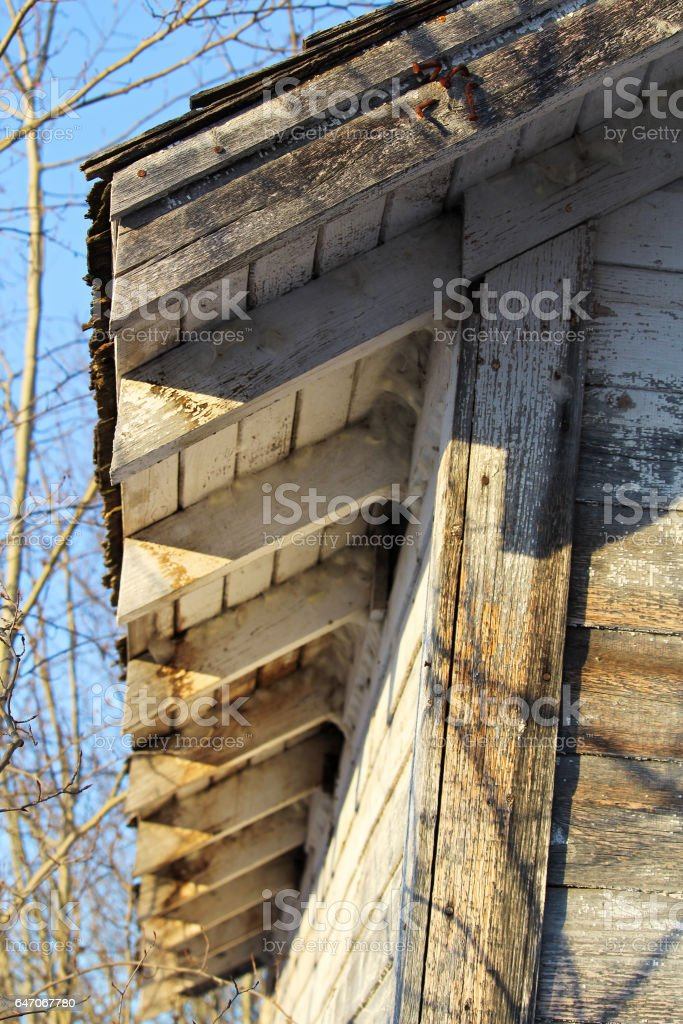 Roof Edge on an Old Abandoned Grainery stock photo