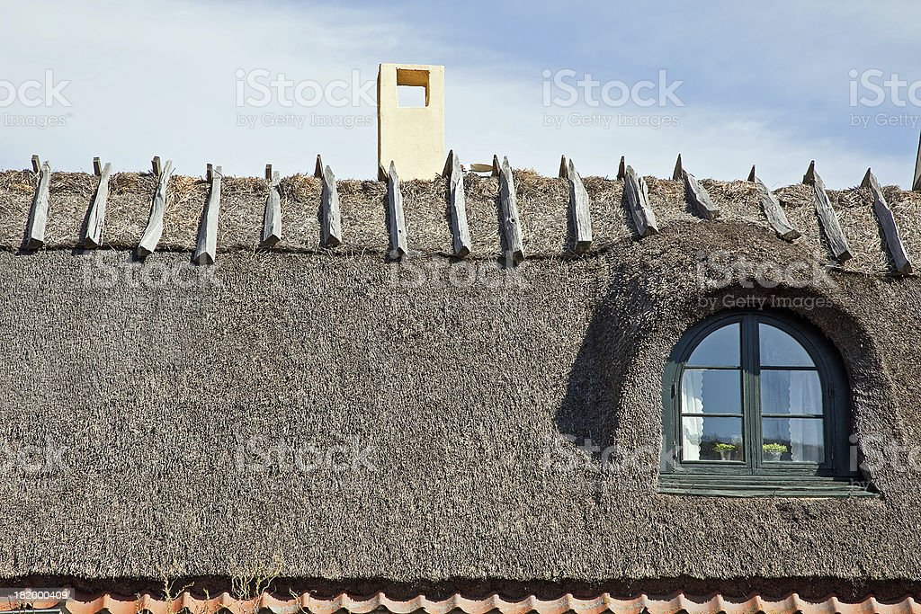 Roof from straw on a house royalty-free stock photo