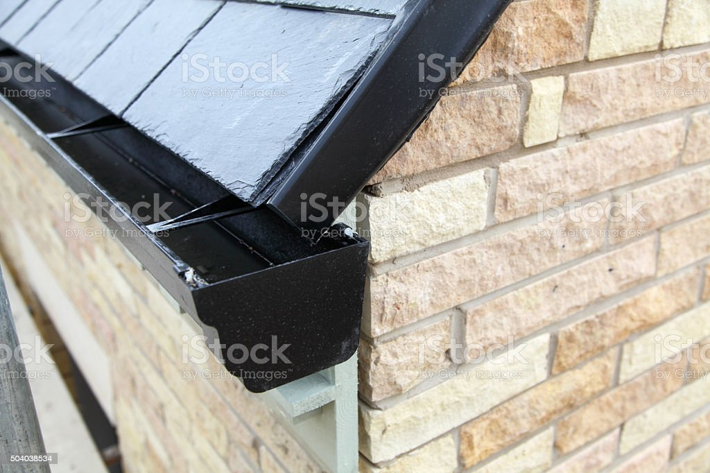 roof guttering on new house stock photo