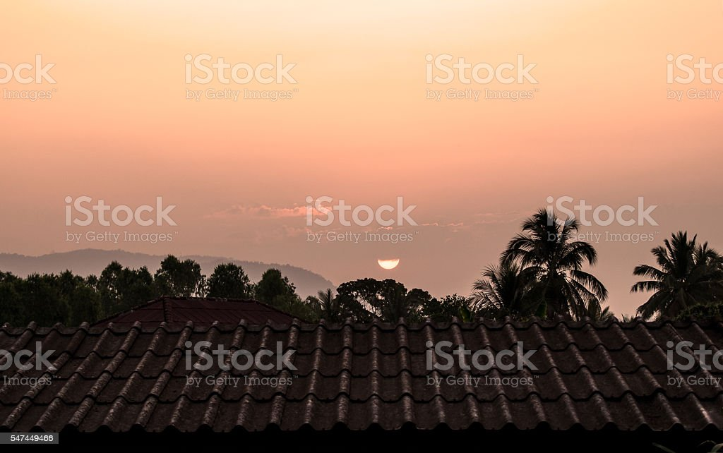 roof house with tiled roof at sunrise stock photo
