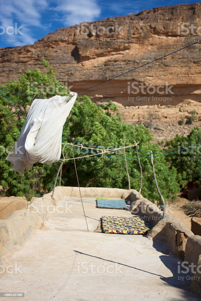 Roof in a Dogon village with cliff, Mali stock photo
