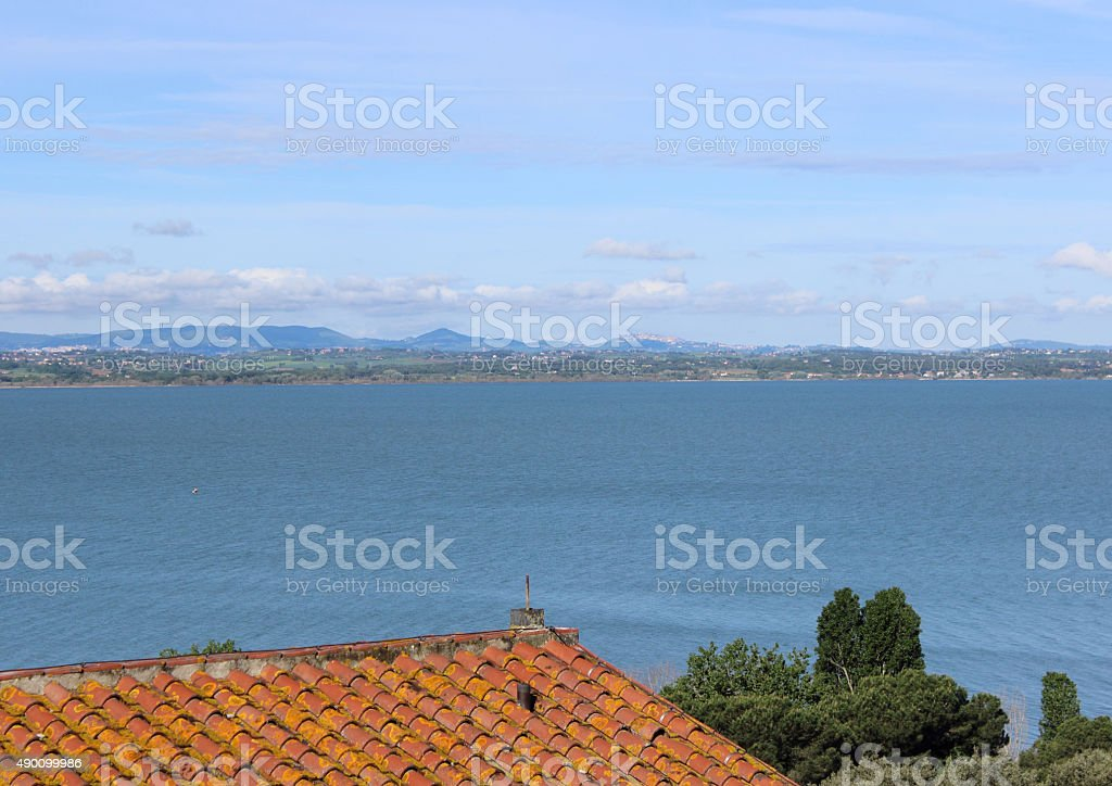 roof of a house on the lake stock photo