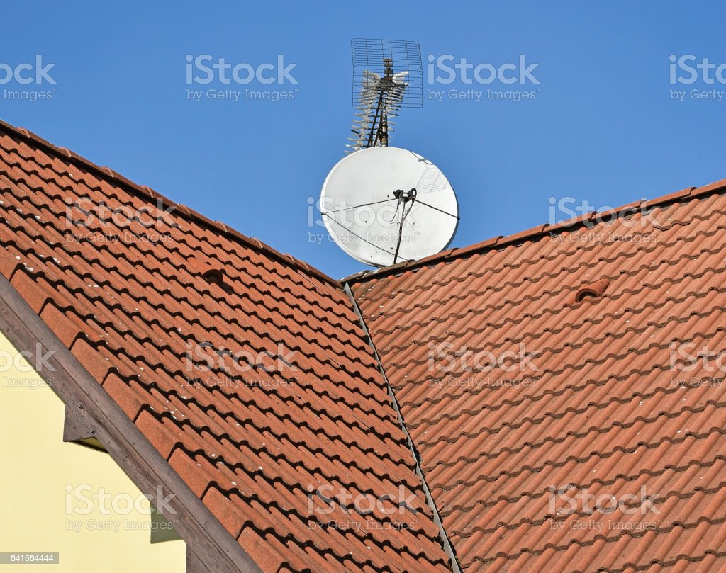 Roof of a house with antennas stock photo