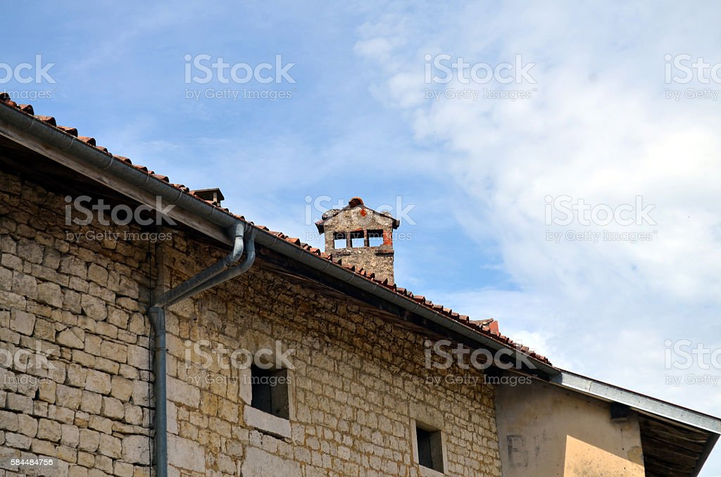 roof of an old french building with chimney stock photo