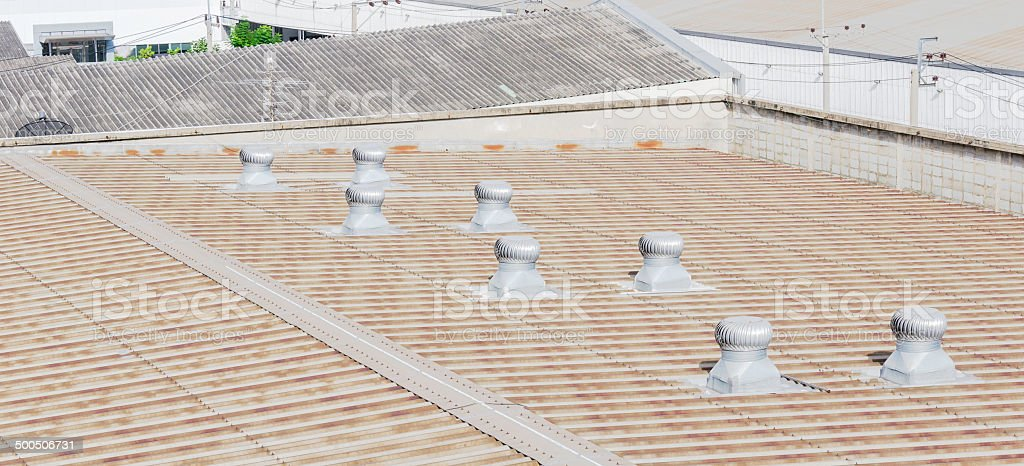 Roof of factory with roof ventilators stock photo