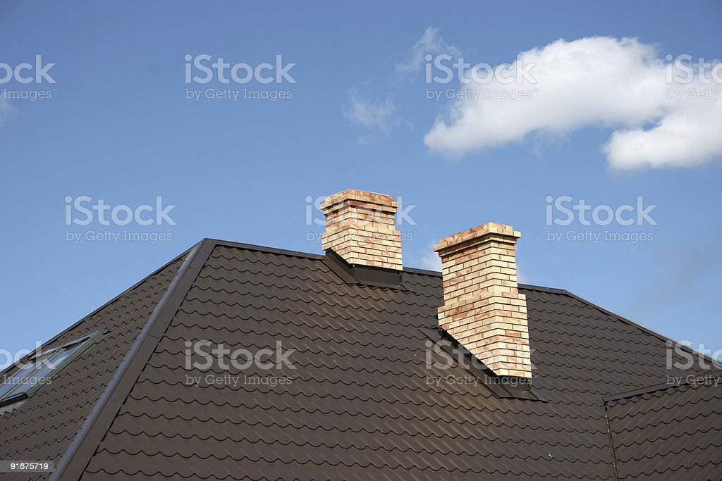 Roof of rooftop apex with 2 chimney stacks & flashing stock photo