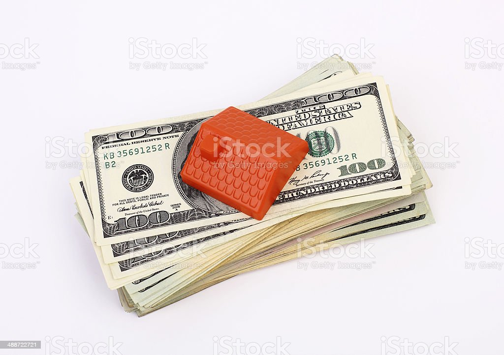 Roof on the stack of Dollars royalty-free stock photo