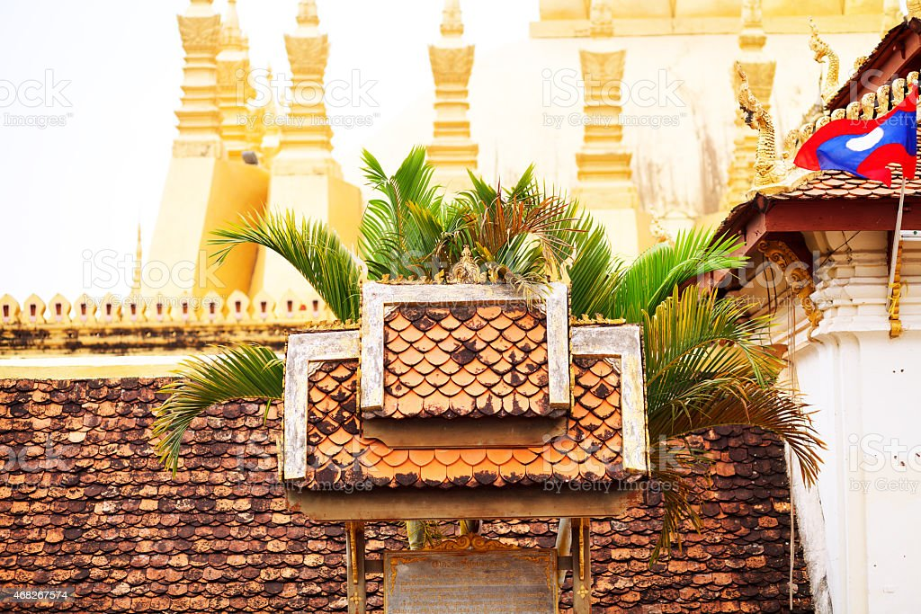Roof on wall around Pha That Luang in Vientiane stock photo
