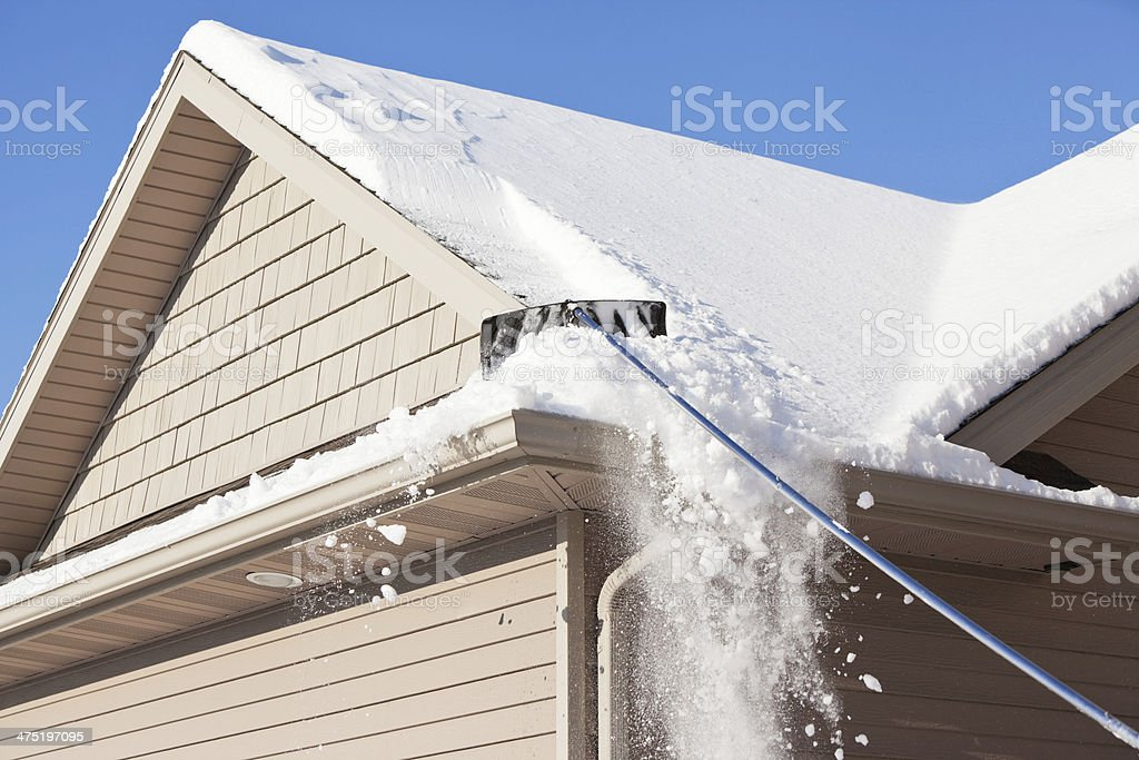 Roof Rake Removing Winter Snow stock photo