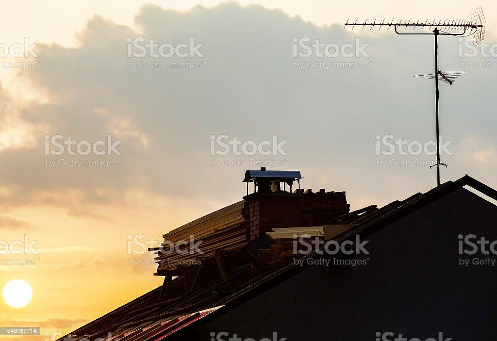 Roof repair work morning scene stock photo