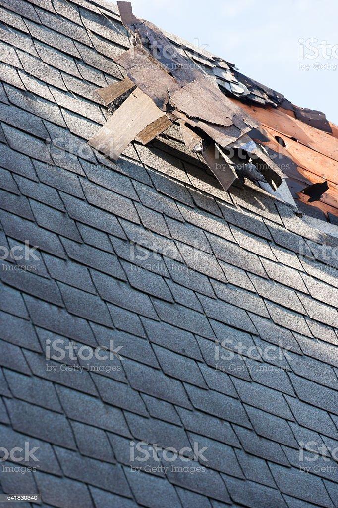 roof shingle damage from storm stock photo