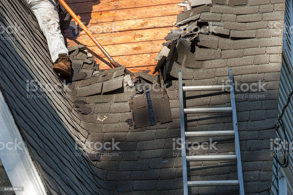Roof shingle removal stock photo