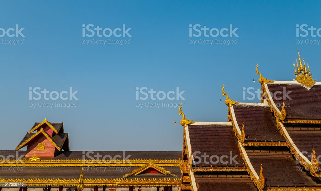 Roof Style of Thai Temple on Blue Sky Background stock photo