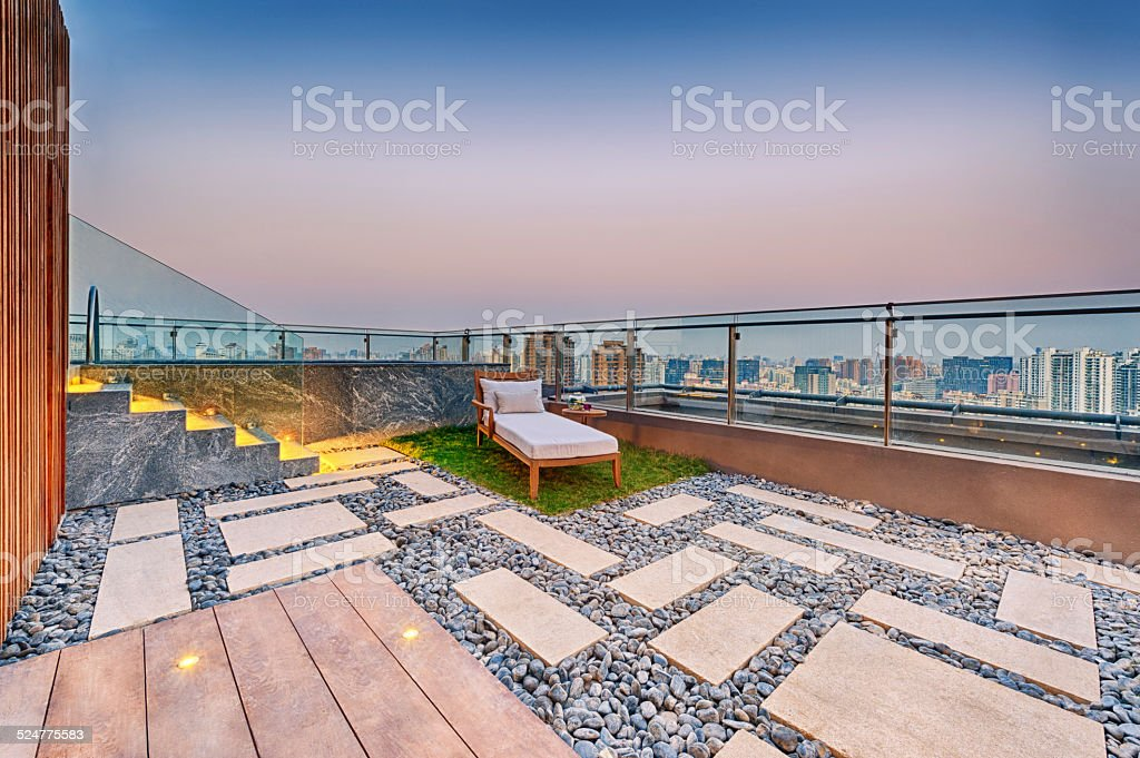 Roof terrace with jacuzzi and sun lounger stock photo