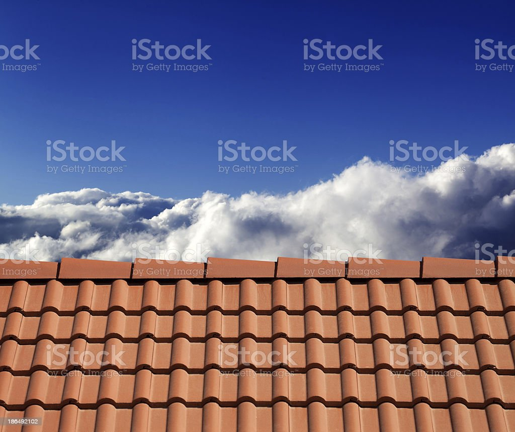 Roof tiles and sunny sky with clouds royalty-free stock photo