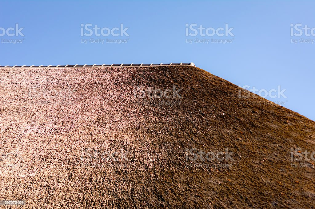 roof tiles on top of thatched roof stock photo