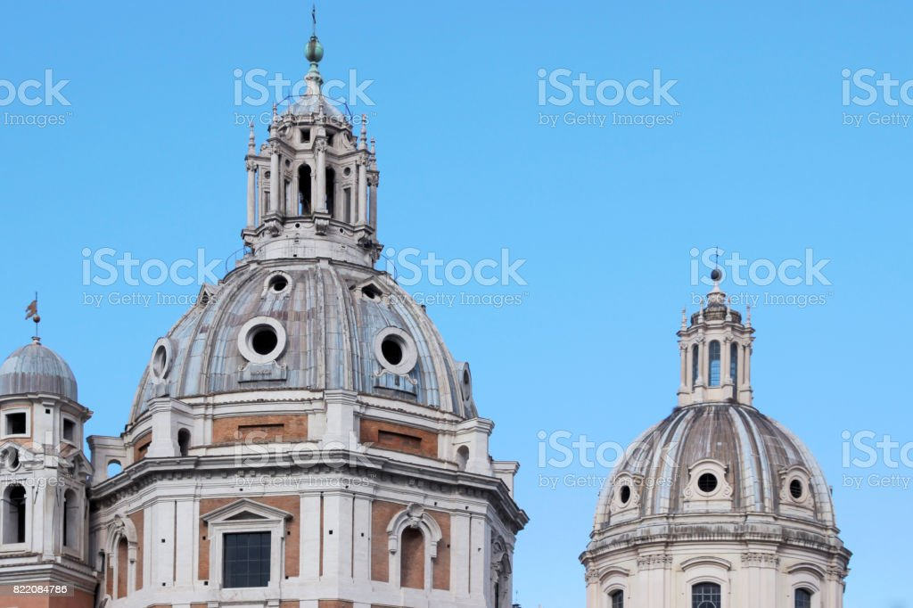 roof top of churchs in blue sky in rome stock photo