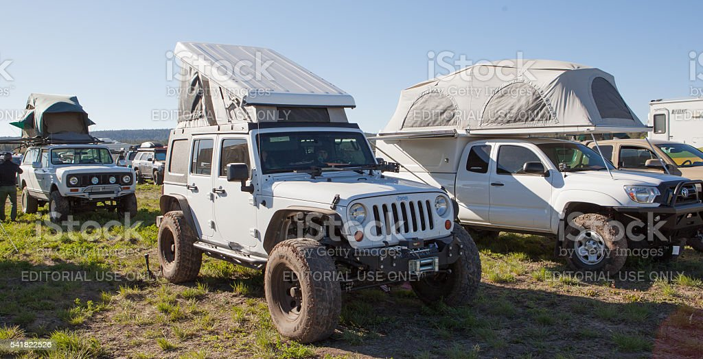 Roof top tents on various vehicles. stock photo
