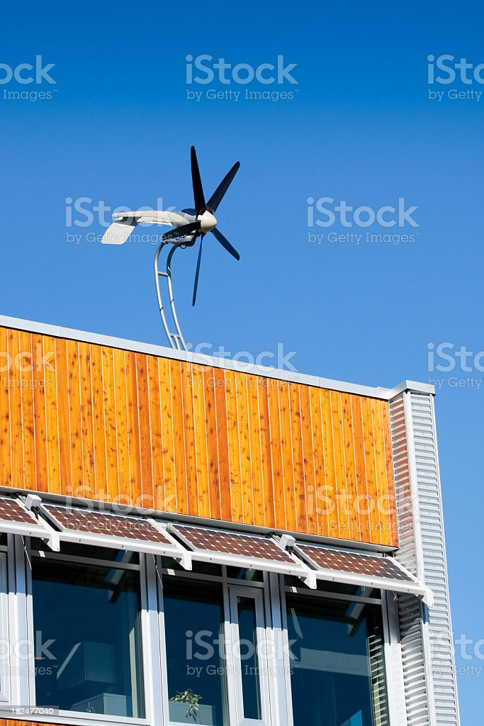 Roof Top Wind Turbine & Solar Panels royalty-free stock photo