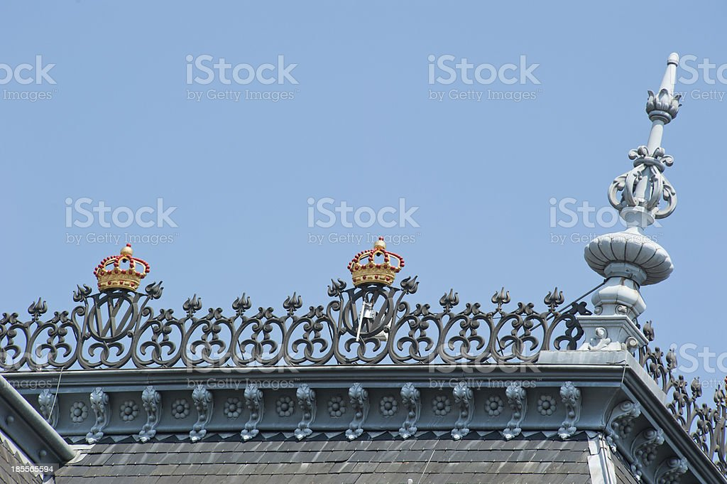 Roof top with ornaments and gold crowns royalty-free stock photo