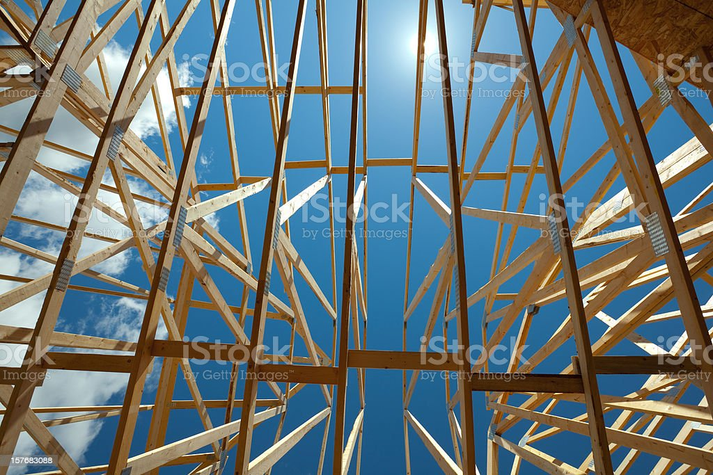 Roof Trusses on New House Under Construction stock photo