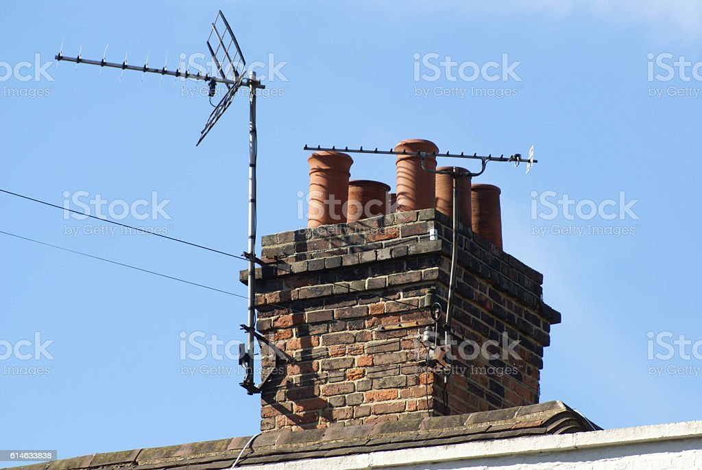 roof with a Chimney and TV aerial stock photo