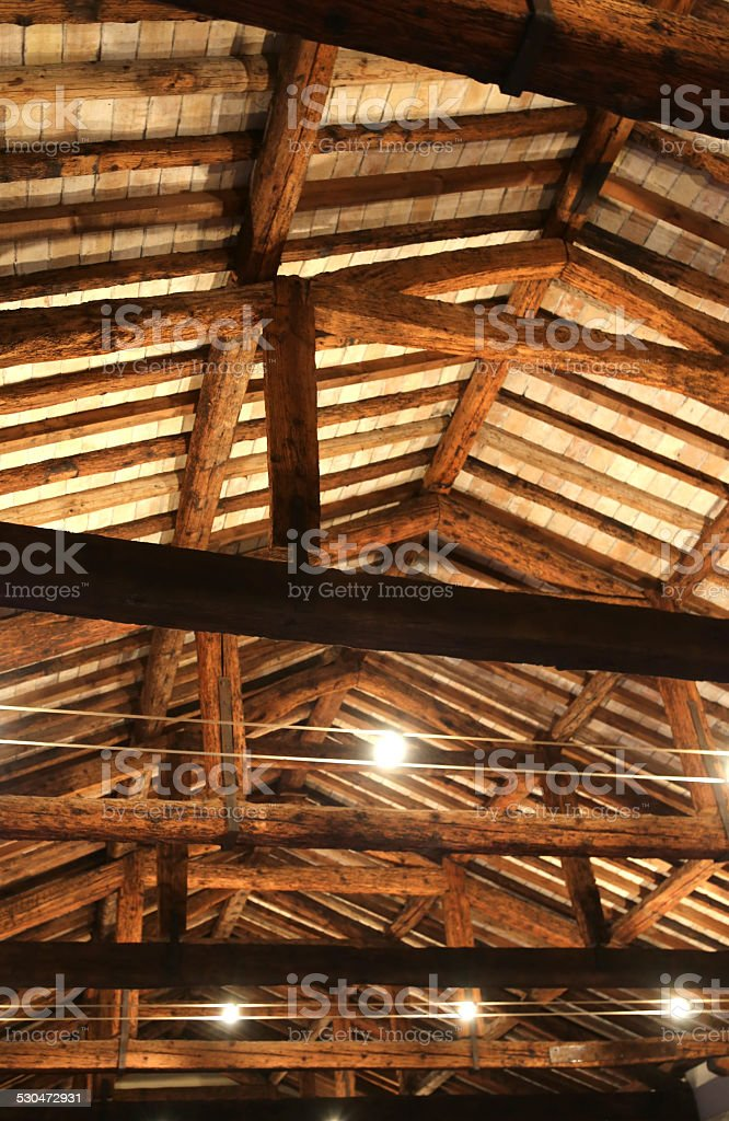 roof with beams facing bricks and halogen lamps stock photo