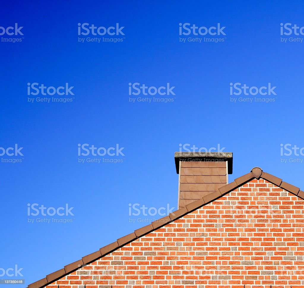 Roof with chimney against a clear sky royalty-free stock photo