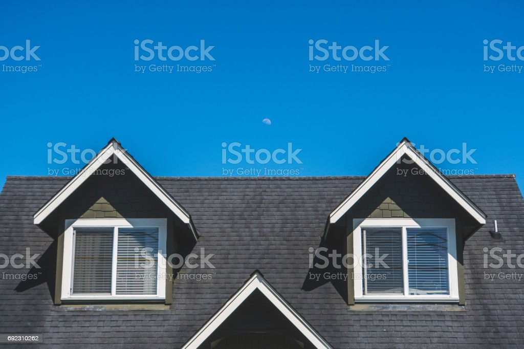 Roof with moon and sky stock photo