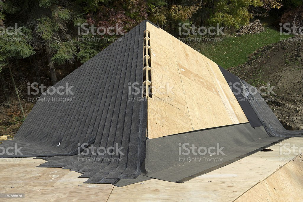 Roof with Ridge Vent Being Shingled royalty-free stock photo