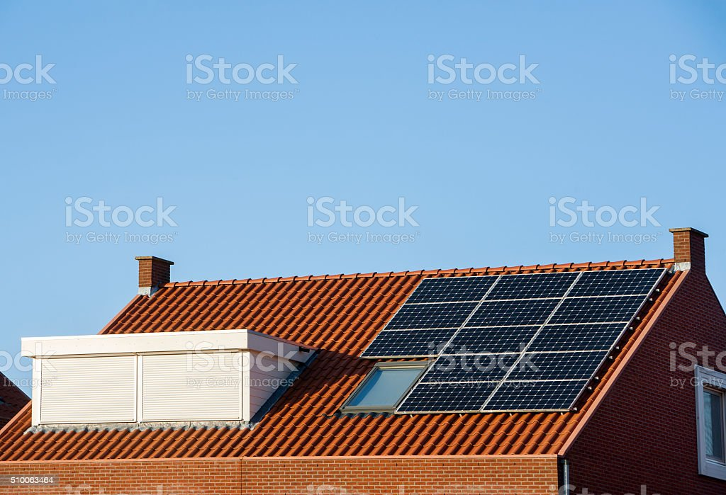 Roof with solar panels and skylight with rolling shutter stock photo