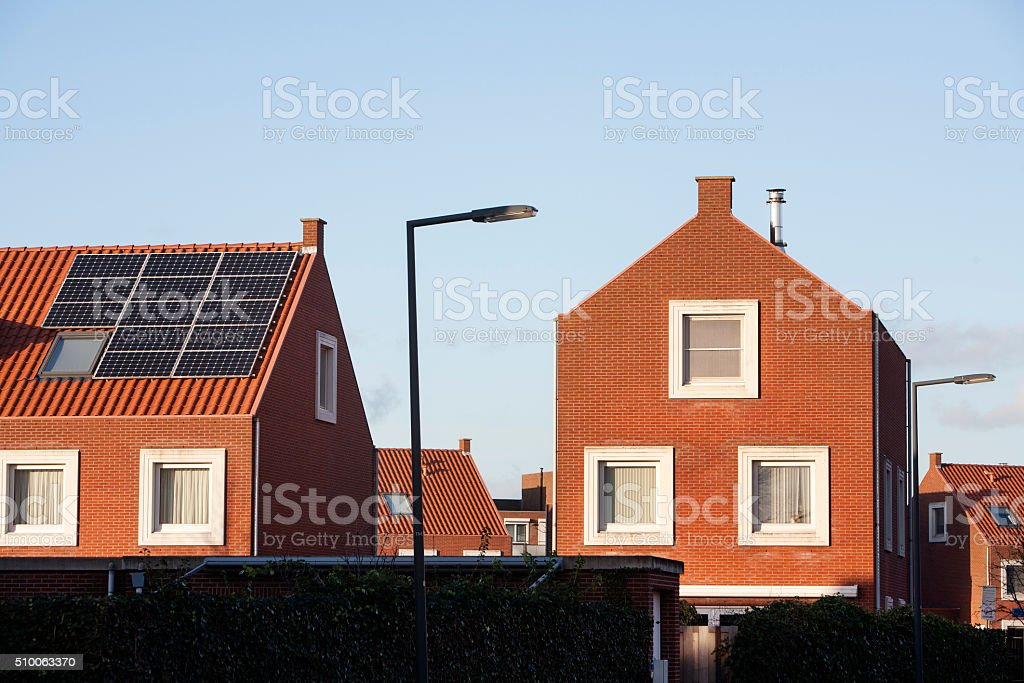 Roof with solar panels in a residential district stock photo