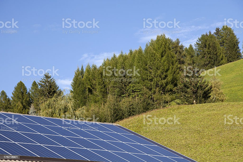 roof with solar panels in the mountains royalty-free stock photo