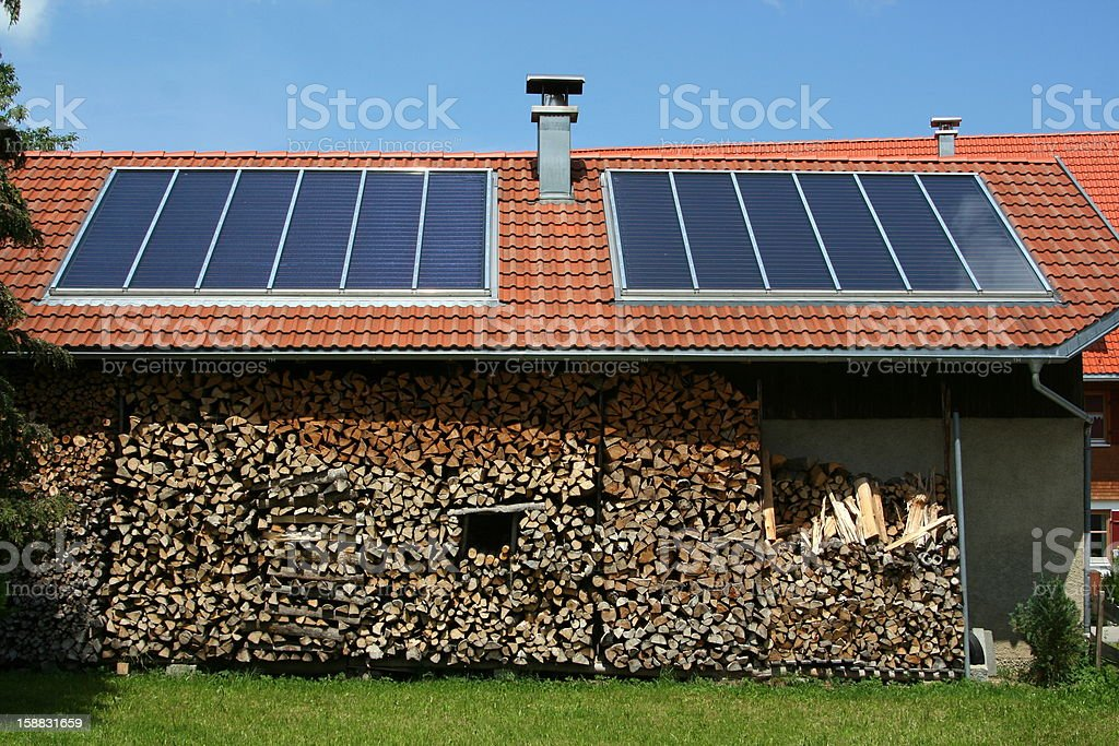 Roof with solar pannels stock photo