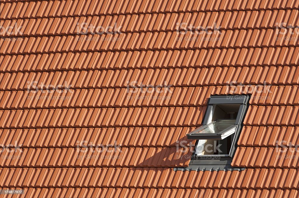 Roof with window, rooftiles stock photo