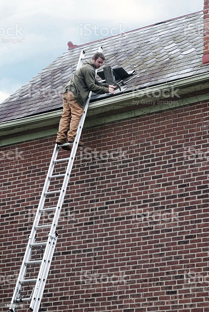 Roof Worker on Ladder stock photo