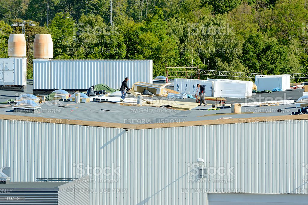 Roof workers stock photo