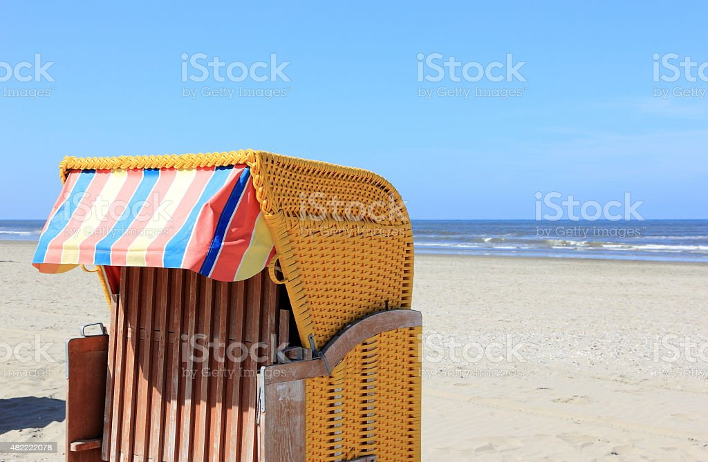 Roofed wicker beach chair. Egmond aan Zee, North Sea, Netherlands. stock photo